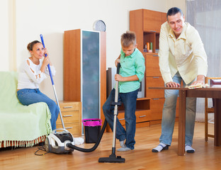 Ordinary family doing house cleaning