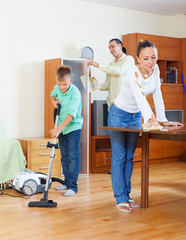 family of three  cleaning in home