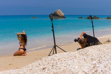 Photoshoot on the beach with beautiful bikini model