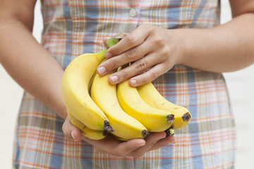 Bunch of organic banana in hands