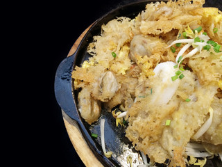 Oysters and squid fried in egg batter or Oyster omelette