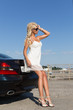 Pretty blond woman and car