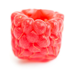 Square (cube) raspberry on a white background