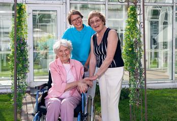 Caregiver for Elderly Patient at Home Garden.
