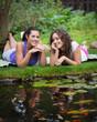 Two beautiful young brunet woman outdoors