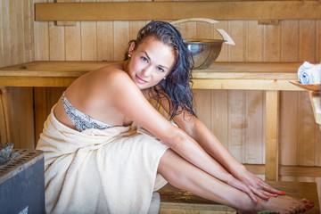 Young pretty woman in sauna