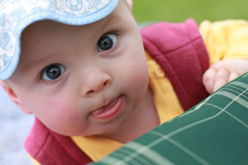 Close portrait of a cute little boy, looking at the camera