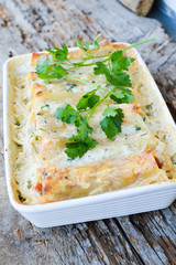 Pasta Cannelloni stuffed with meat, white Bechamel sauce, cheese