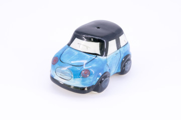 pepper shaker and saltcellar in car shape ceramic isolated on wh
