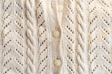Knitted fabric with white buttons closeup
