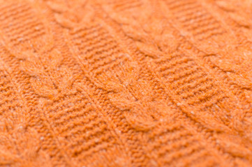 Closeup on Orange Handmade Knitted Fabric pattern