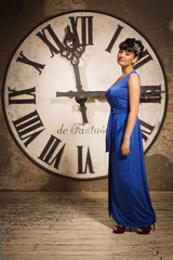 Woman on the background of a large clock face