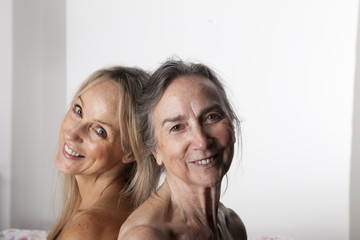 Portrait of old woman in her eighties with her adult daughter