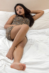 sexy woman lying in bed