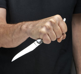 Man with a knife in a hand. Closeup