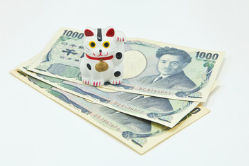 Lucky cat on Japanese Yen banknotes