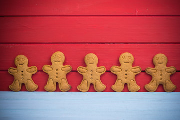 Gingerbread man on wooden red background