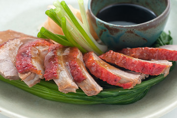Fried duck with ginger on a plate
