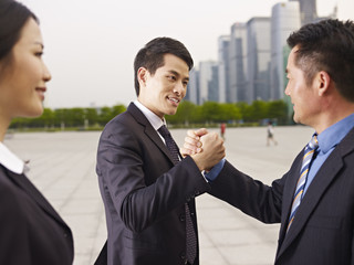 asian business people greeting each other