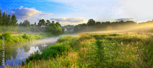Leinwandbild Motiv panorama of a summer landscape with sunrise, fog and the river