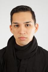 Hispanic man in black turtle neck, looking serous