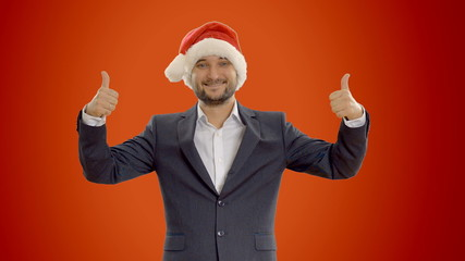 young man shows copy space  in a hat santa claus