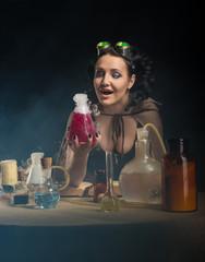 Alchemist girl with test tubes