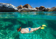 Woman snorkeling in tropical water - 71092564