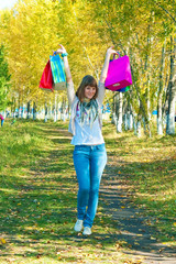 The girl with multi-colored packages going on park