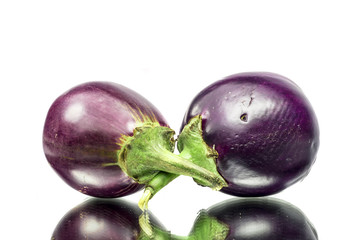 Two brinjals with reflection