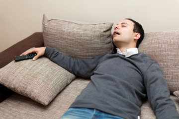 Man sleeping while watching tv