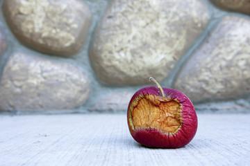 Partly eaten rotten fruit.