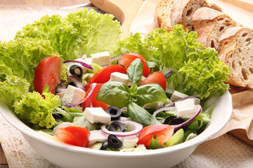 Vegetable salad with feta cheese and black olives