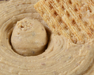 Hummus and cracker closeup