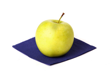 Small green apple on a napkin