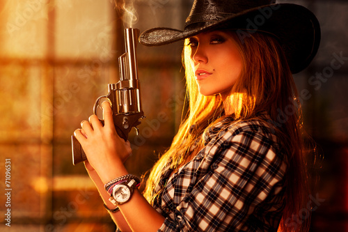 canvas print picture Young woman with gun