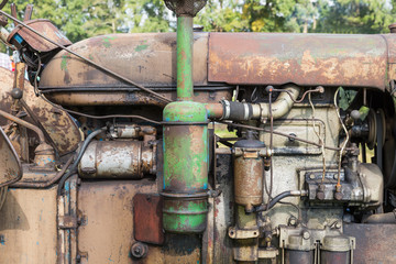 Closeup of the engine of an old tractor