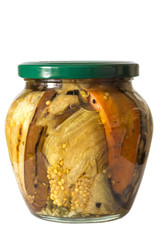 Jar with vegetables on a white background