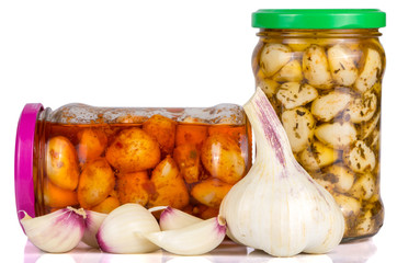 jars with pickled and fresh garlic
