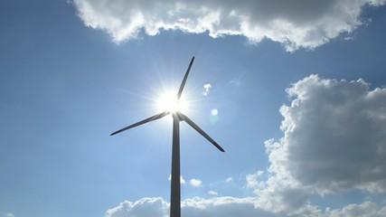 Windgenerator with rays of sun effect