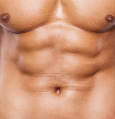 Close up of fitness man torso with beautiful six pack