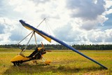 Yellow ultralight trike is parked on the earth