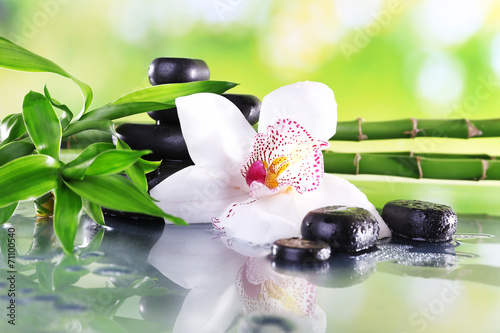 Fotobehang Bloemen Spa stones, bamboo branches and white orchid