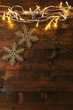 Garland and snowflakes on wooden background