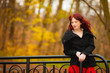 Fashion woman relaxing walking in autumn park