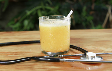 orange juice, healthy with stethoscope