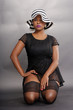 Expressions of a caribbean girl in lingerie with striped hat