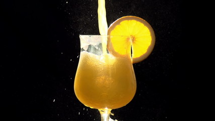 Stream of Orange Juice in a Glass