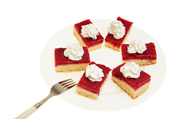 Currant cake with whipped cream on a plate with fork