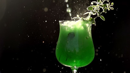 Green Soda Being Poured into a Glass